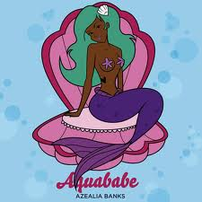 Mermaid in a clamshell with green hair.