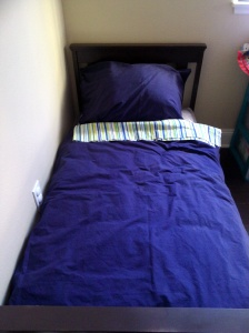 The duvet and pillow sham on the bed!