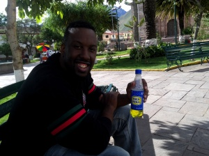 Chillin' at the plaza in Urubamba with an Inka Cola.