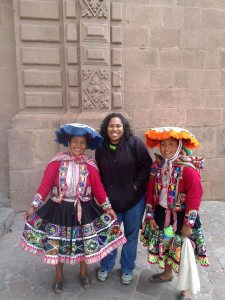 Her in Cusco. I wanted to take a photo with the woman in the blue hat ... the woman in the orange hate photo bombed me! Lol