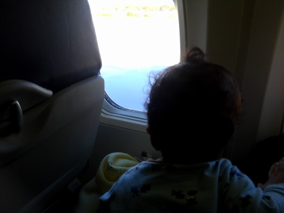 Baby watches descent onto the tarmac.