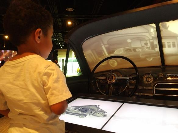 2018 DC AAM interactive car exhibit Guillermo playing.jpg